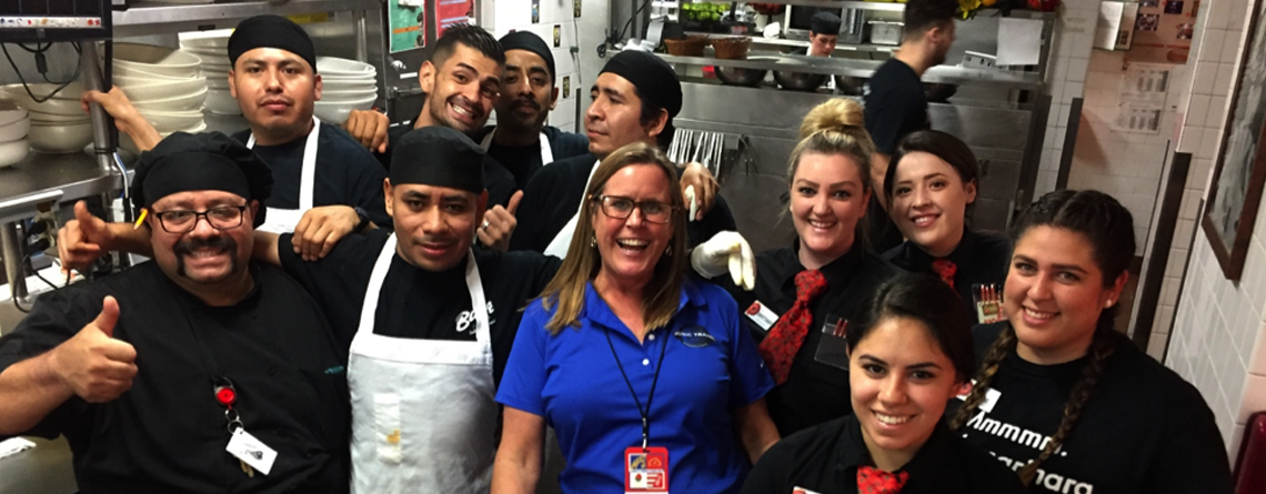 Nancy checking in with the kitchen and wait staff at Buca di Beppo Italian Restaurant before a Music Travel dinner.