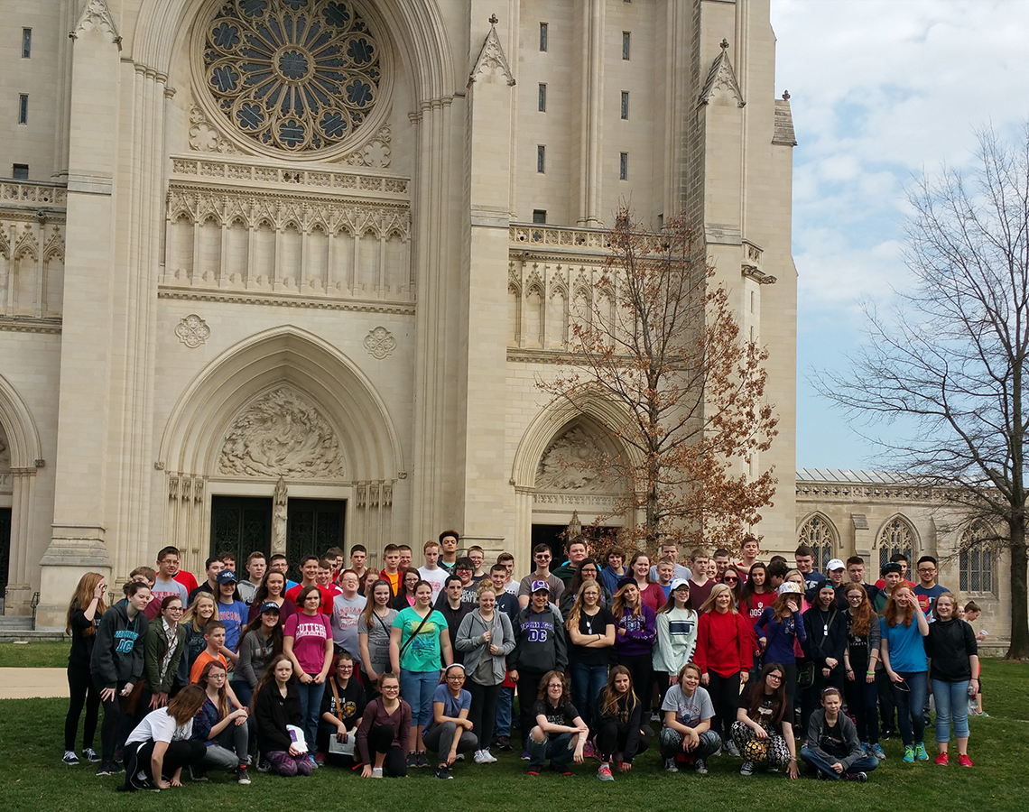Teri Aitchison sharing a memory with Bedord Middle School Band visiting the Washington Cathedral - constructed of Bedford limestone.