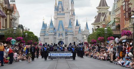 The Franklin Community Blue Regiment Marching Band performing in the Festival of Fantasy Parade at Walt Disney World.
