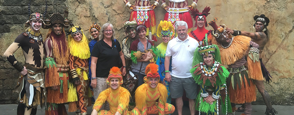 """Tour Directors Sue Guindon, Paige Carter & Chuck Kubly meeting the cast of """"Festival of the Lion King"""" at Disney's Animal Kingdom."""