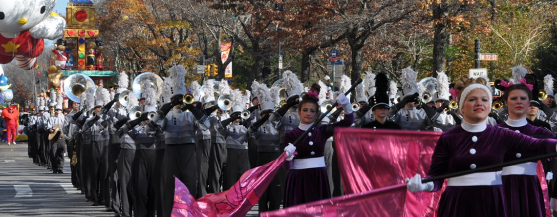 Marching in the Macy's Thanksgiving Day Parade with Music Travel Consultants