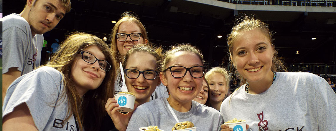 The Bismarck High School Choir enjoying treats during the baseball game.
