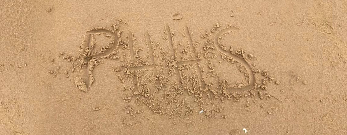 The Pendleton Heights Choir left their mark in the sand at Normandy.