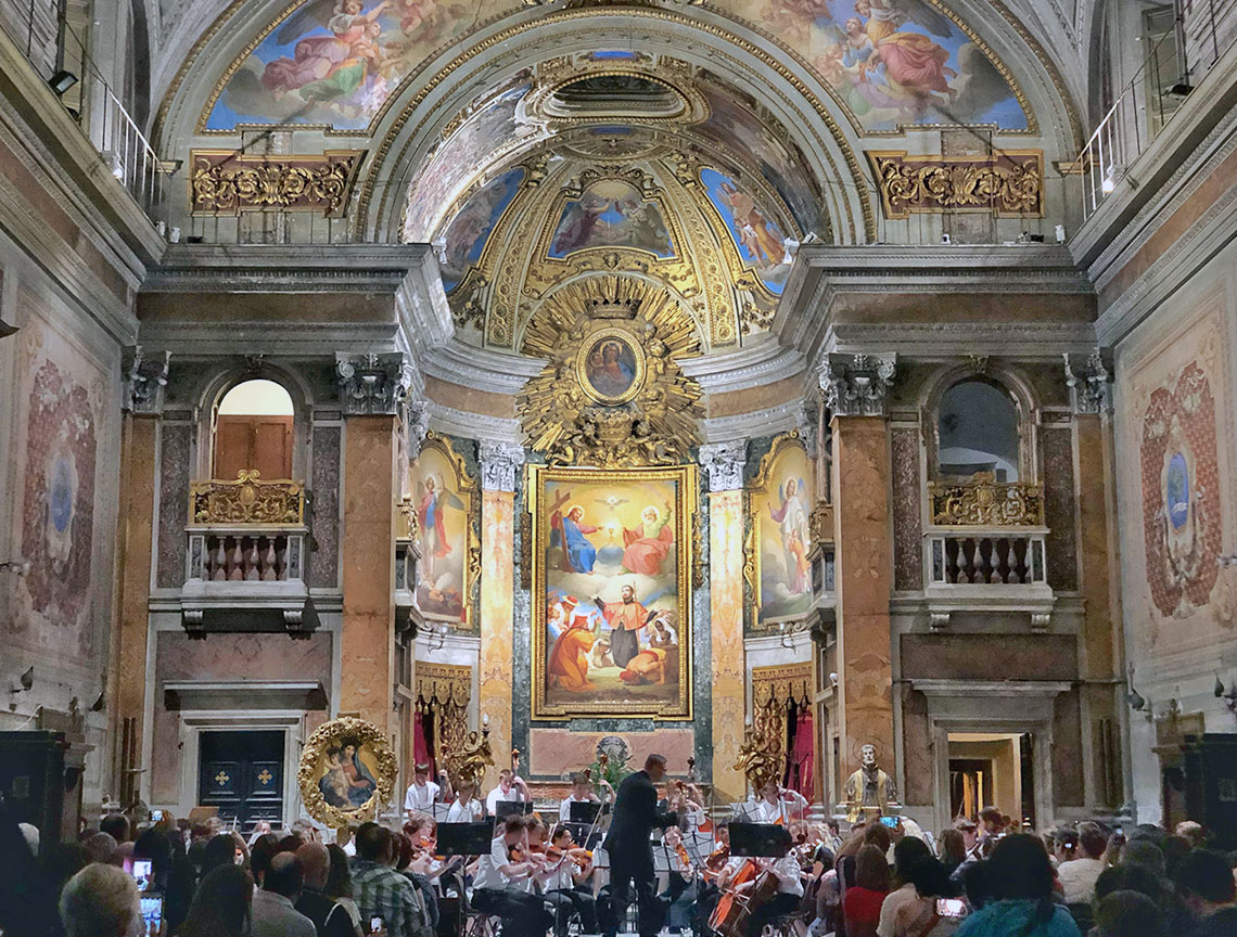 The Avon High School Orchestra from Indiana performs for a packed house in Rome at the Oratory of San Francesco Saverio del Caravita.