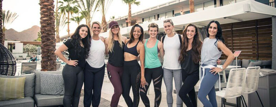 Paige (in green) flanked by friends at the LuLulemon yoga instructors summer conference in Scottsdale, AZ.