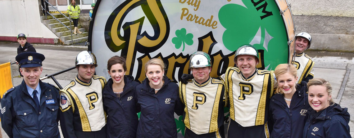 "Members of The Purdue ""All-American"" Marching Band posing with the World's Largest Drum."