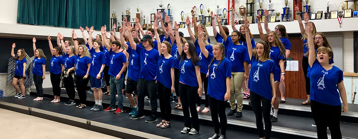 Who wants to go to France? The Pendleton Heights Choir holding their last rehearsal before boarding a flight to Paris.