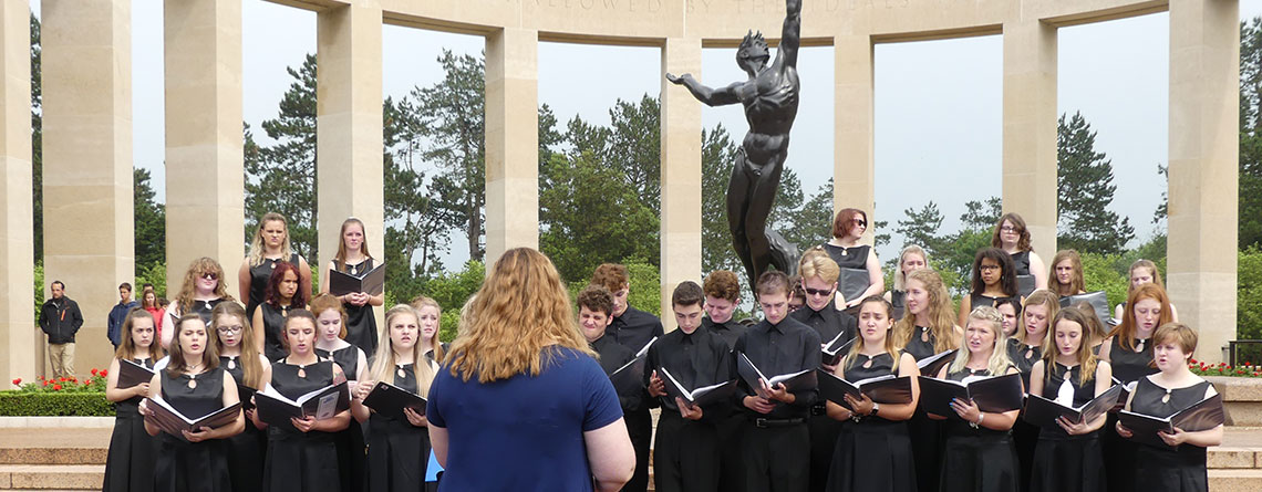 The Pendleton Heights Choir Performing at the Normandy American Cemetery, the final resting place for more than 9000 American soldiers.