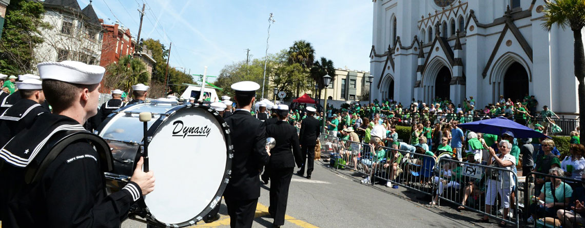 A marching band turning by the cherished Cathedral of St. John the Baptist (A Roman Catholic cathedral).