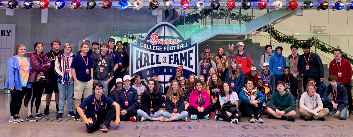 Marching Bands don't wear helmets!  West Marching Band at the College Football Hall of Fame.