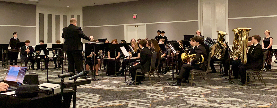 The West High School Concert Band competing at at the Grand Ballroom at the Renaissance Concourse Atlanta.