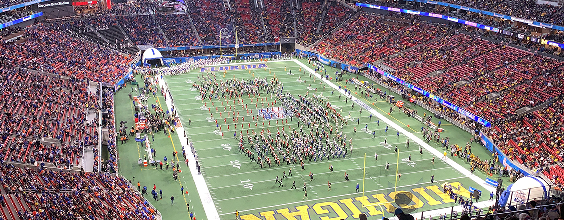 The West High School Marching Band along with the other 6 bands performing before the Peach Bowl.