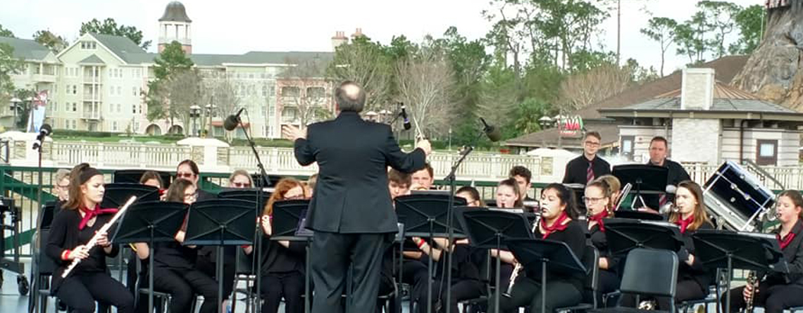 Another picture of the Sidney High School Concert Band performing on stage.