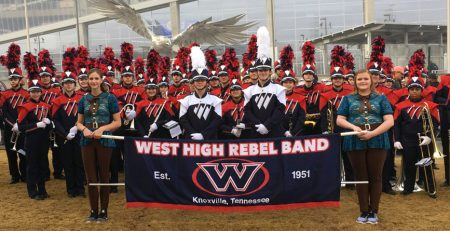 The West High School Rebels Marching Band in front of Mercedes-Benz Stadium.