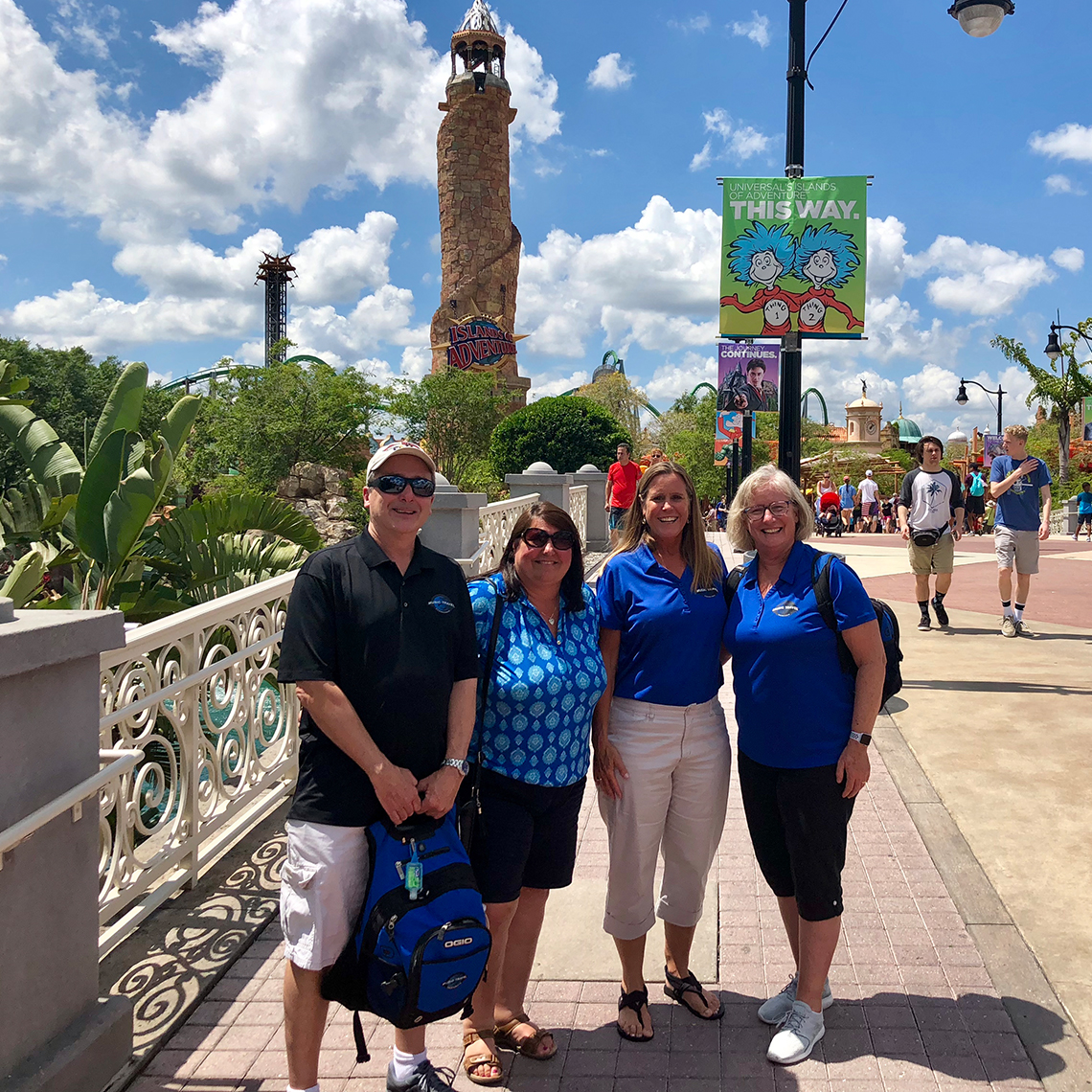 From left to right: MTC Tour Directors Tom Young, Kathy McGrady, Nancy Reichmann, and Sue Sue Guindon at Universal's Islands of Adventure™ Theme Park.