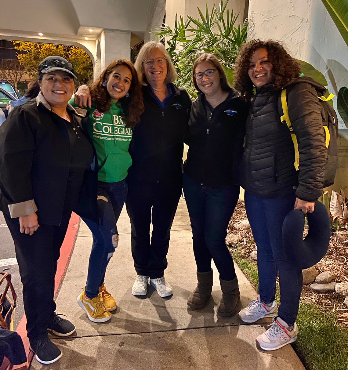 From left to right: MTC Tour Director Sylvia Duplantier, UPR Drum Major Rebeca Santiago, MTC TD Sue Guindon, MTC TD Vicky Wielosinski, and UPR Staff Member Shara Vargas Jimenez at the Pasadena Tournament of Roses Parade with the Centennial Collegiate Band of Mayagüez University, the first Puerto Rican University Marching Band to be a part of the parade!