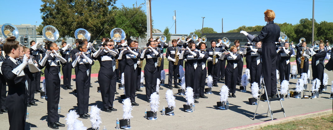 Tom Glenn High School marching band warms up prior to a fall performance. The drum majors at Glenn have implemented several ideas to keep the students engaged.