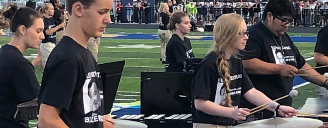 Members of the Elkhart Central HS front ensemble present an early-season performance of their program. The students practice many hours together to improve their individual skills as they relate to the others in the ensemble.