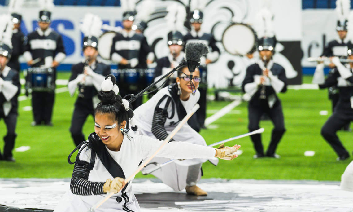 Color guard members perform during a show with the Tom Glenn High School Grizzly Band. Kim Shuttlesworth is the director of bands.