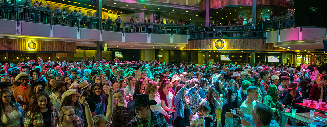 Students pack the dance floor during the HOA Wildhorse event. Nearly every competing group participated in the night out.