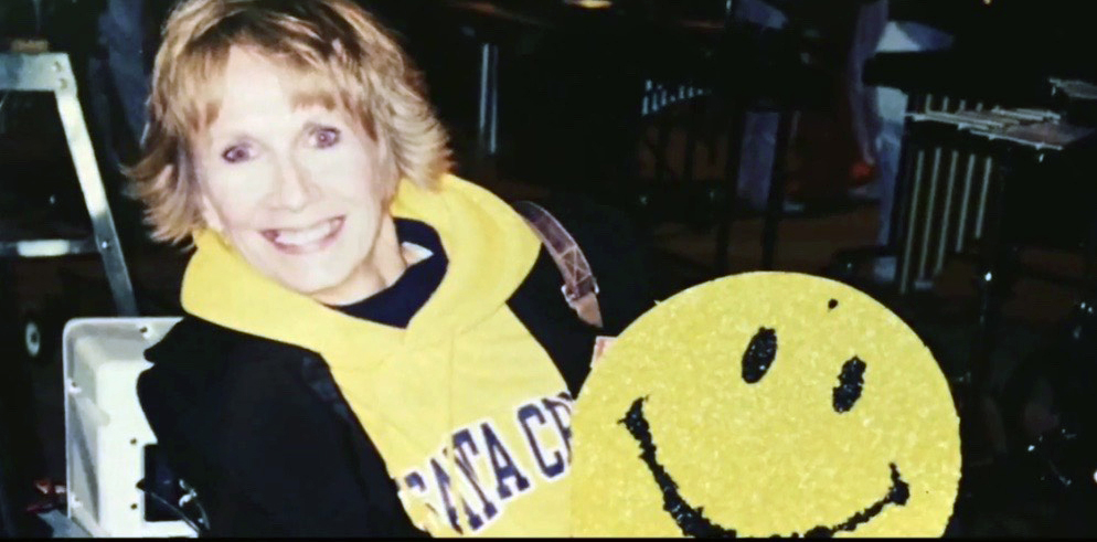 Patt Elff grabbed the smiley face from her middle school classroom and used it in the stands as a way for her daughter to easily spot her during a performance.